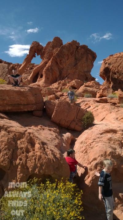 boys climbing rock