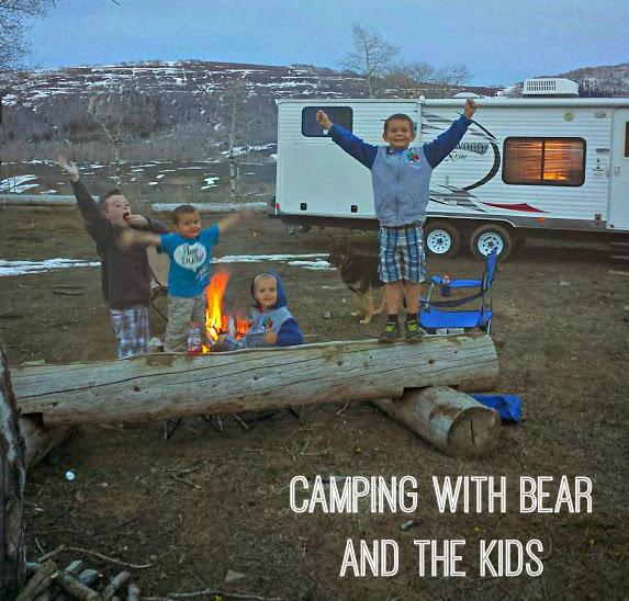 bear and kids camping